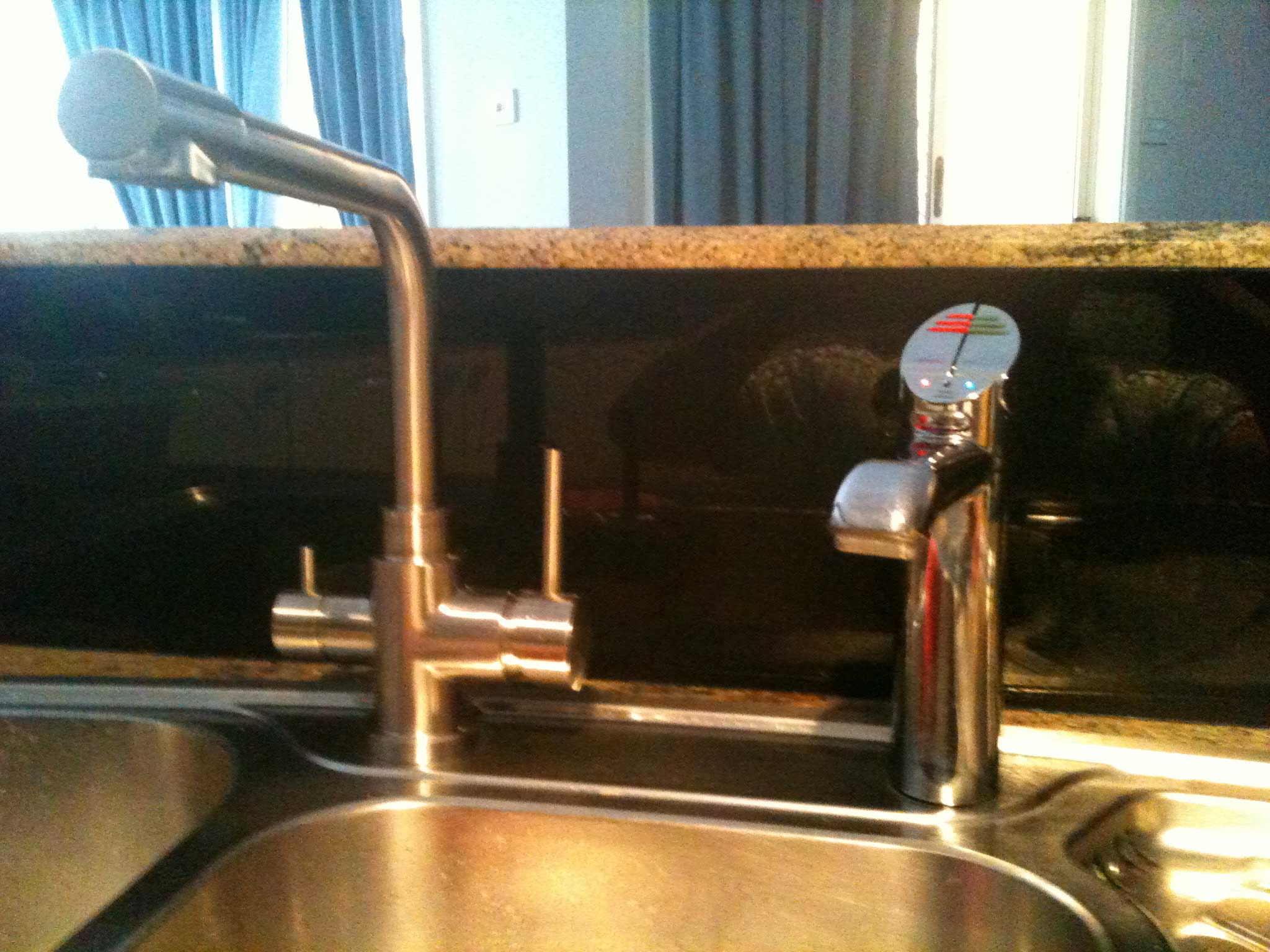Stainless Steel Three Way Mixer with ZIP Hydrotap installed on kitchen sink